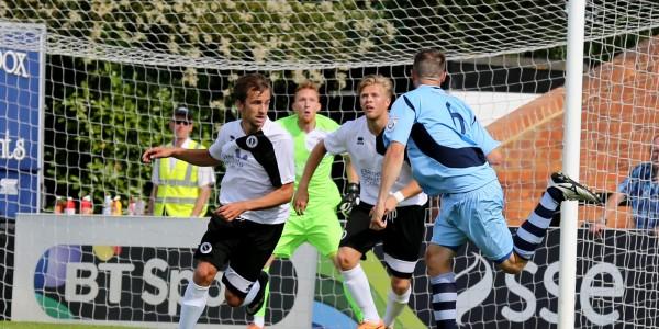 Darren Locke heads towards goal