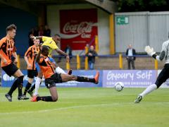 Michael Malcolm shoots towards goal