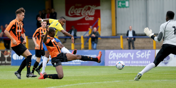 Michael Malcolm shoots towards goal
