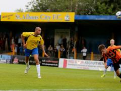 Simon Thomas heads towards goal against Barnet