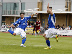 Billy Medlock has a shot from inside the Chelmsford penalty area