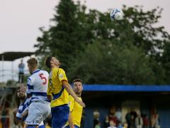 Darren Locke challenges for the ball