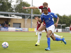 Ghassimu Sow powers in the Clarets penalty area with Mark Haines in close attention