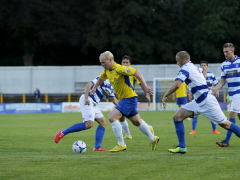 Lewis Hilliard slices through the Oxford City defence