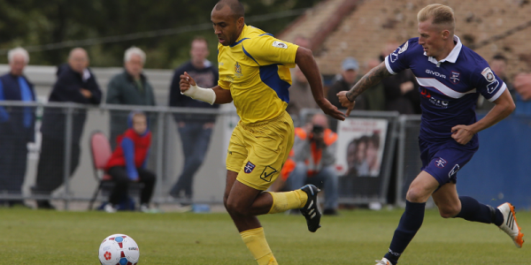 James Comley stretching the Margate midfield