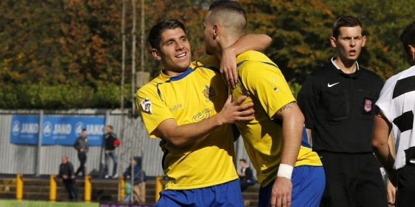 John Kyriacou congratulates Louie Theophanous on opening the scoring in the third minute and scoring the Saints 300th home FA cup goal