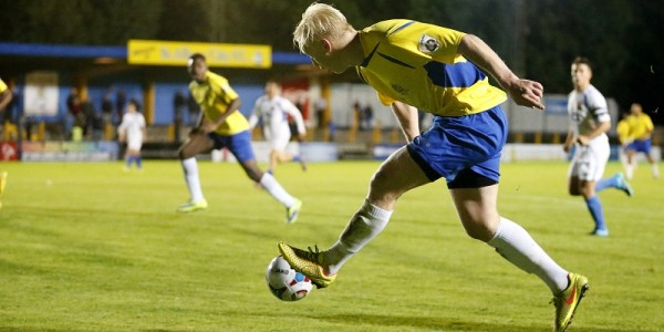 Lewis Hilliard fires the ball into the path of Jordy Ndjeka