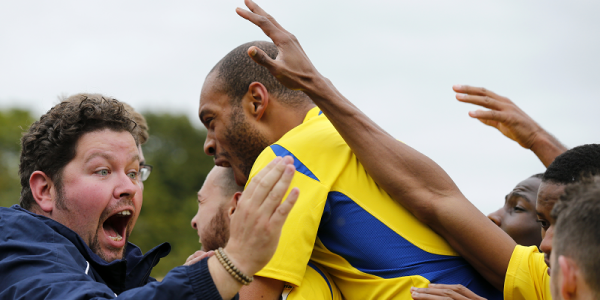 The Saints fans and players celebrate the goal that gave the Hertfordshire club their first win of the season