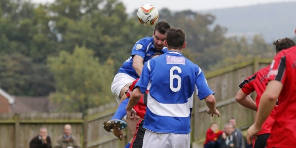 Ben Martin wins the header to put the Saints into the next round of the cup
