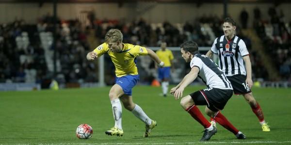 Ben Nunn powers into the Grimsby penalty area