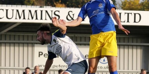 Billy Gibson rises the highest, but is unable to direct his header towards goal