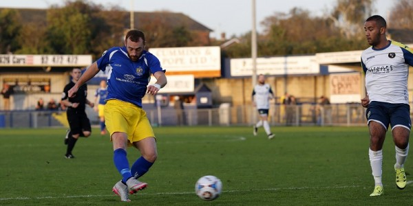Harry Crawford has a shot from the edge of the box