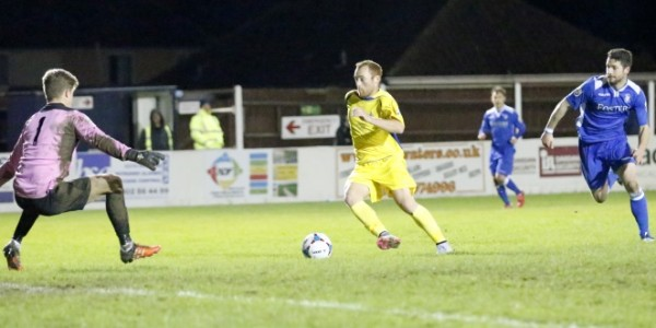 Harry Crawford is denied an opportunity to keep the Saints in the game as the small Lowestoft keeper Ben Killip makes himself large