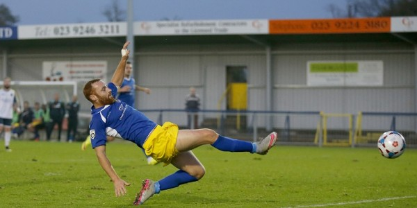 Harry Crawford is unable to direct the ball into the net