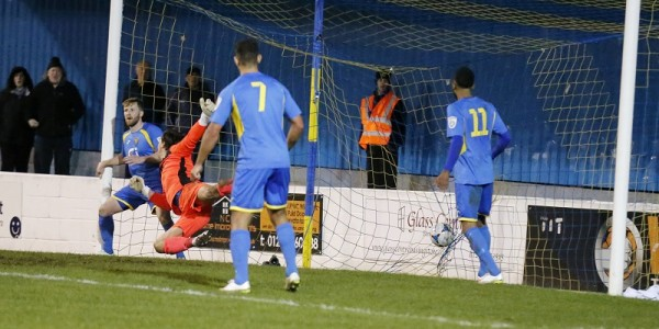 BACK OF THE NET Ben Martins powerful header flies nto the back of the net to earn the Saints a draw