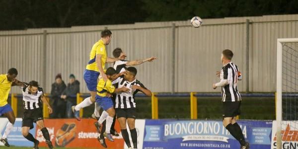 Ben Martin rises high to score the Saints second goal