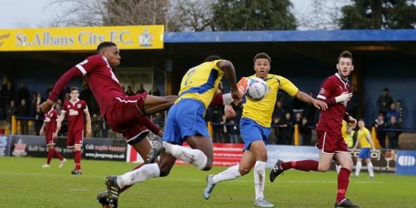 Eddie Oshodi bravely heads the Saints into a first half lead