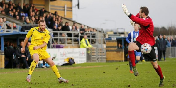 Harry Crawford tries to take advantage as Stortford keeper Ross Fitzsimons finds himself stranded