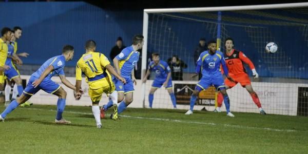 Jernade Meade looks on as his shot is drifts wide of the Basingstoke goal