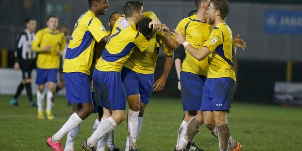 Jonathan Edwards is mobbed as he secures a late winner for the Saints