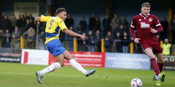 Jonathan Edwards shots towards goal