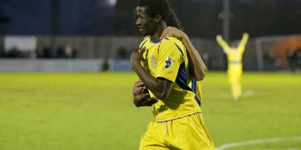 Jorell Johnson congrulates Eddie Oshodi on scoring the equalising goal
