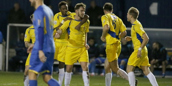 Kevin Krans celebrates with Sam Corcoran after he scored the Saints first from range