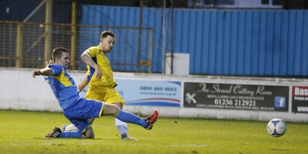 Louie Theophanous looks on as his shot is saved by Aaron Howe