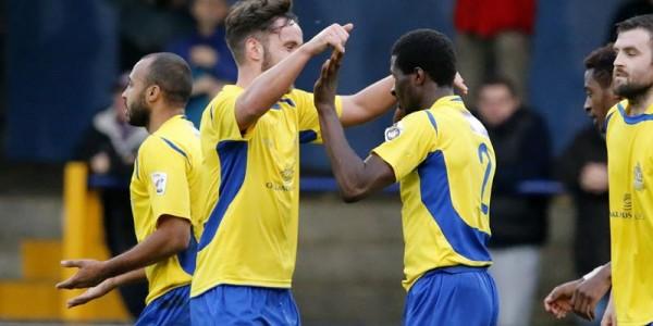 Sam Corcoran congratulates Eddie Oshodi on scoring the opening goal