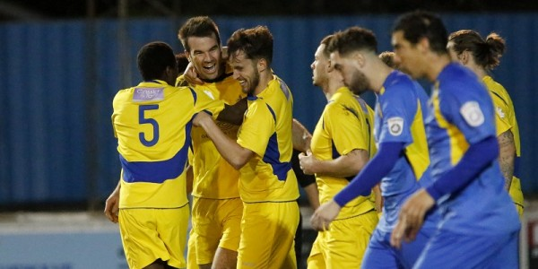 The Saints celebrate with Ben Martin after his header secured a point