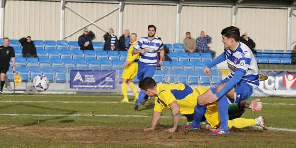 Charlie MacDonald looks on as his shot goes into the back of the net