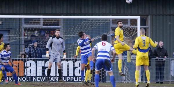Darren Locke heads clear the danger