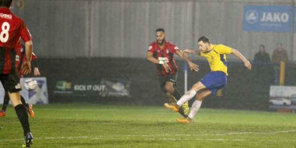 Luoie Theophanous fires the ball towards Ross Fitzsimons goal