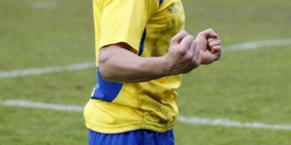 Michael Thalassitis celebrates scoring the second goal of the game