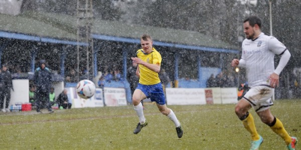 As the snow falls Harry Anderson tries to get onto a loose ball