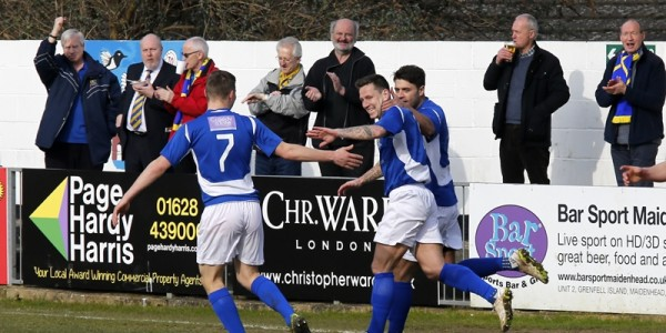 Charlie MacDonald celebrates his goal with Michael Thalassitis and Harry Anderson