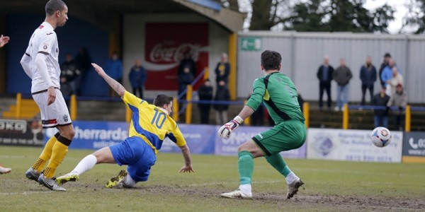 Charlie MacDonald looks on as his header creeps wide of the Sutton goal