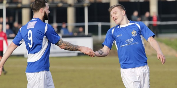 Louie Theophanous congratulates Harry Anderson on scoring the third city goal of the afternoon