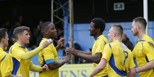 The Saints congratulate with Eddie Oshodi after he put the Saints into the lead