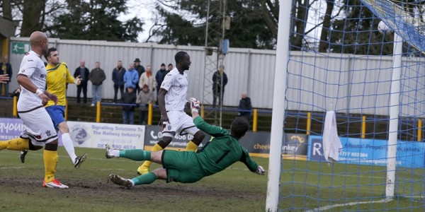 The ball goes just wide of the sutton goal