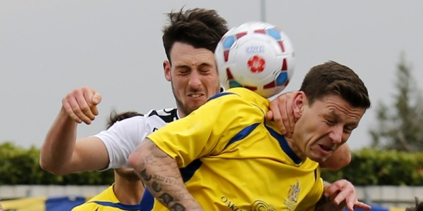 Charlie MacDonald is unable to get his head on the ball to direct the ball goalwards