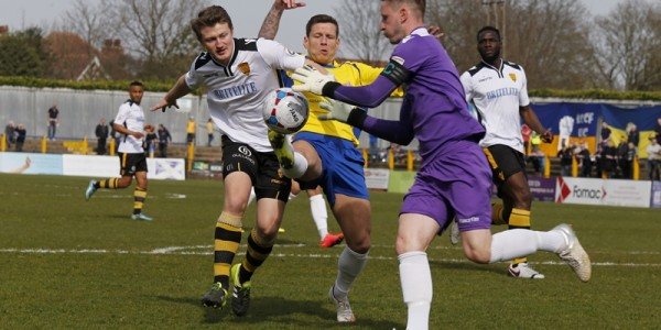 Charlie MacDonald tries to nick to the ball as Maidstone's keeper Lee Worgan comes to claim