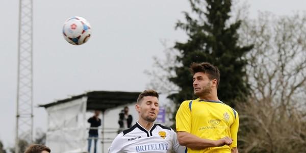 Michael Thalassitis heads the ball goalwards