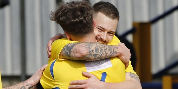 Sam Corcoran celebrates with Louie Theophanous after Louie brought the Saints level