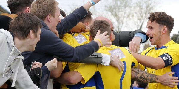 The Saints fan celebrate with Louie Theophanous after his early goal