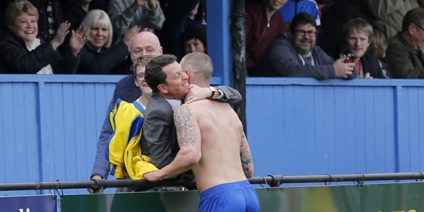 Louie Theophanous celebrates his goal with owner Lawrence Levy
