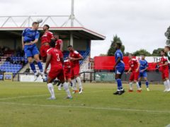 Josh Hill heads towards the Welling goal