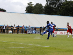 Junior Morias fires the ball into the back of the net from the penalty spot to claim all three points for the Saints