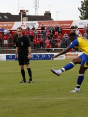 Dipo Akinyemi outs the ball wide of the goal