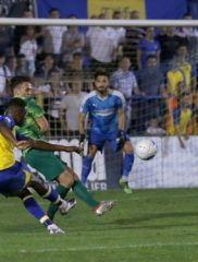 Dipo Akinyemi tries to curl the ball into the top corner of the net